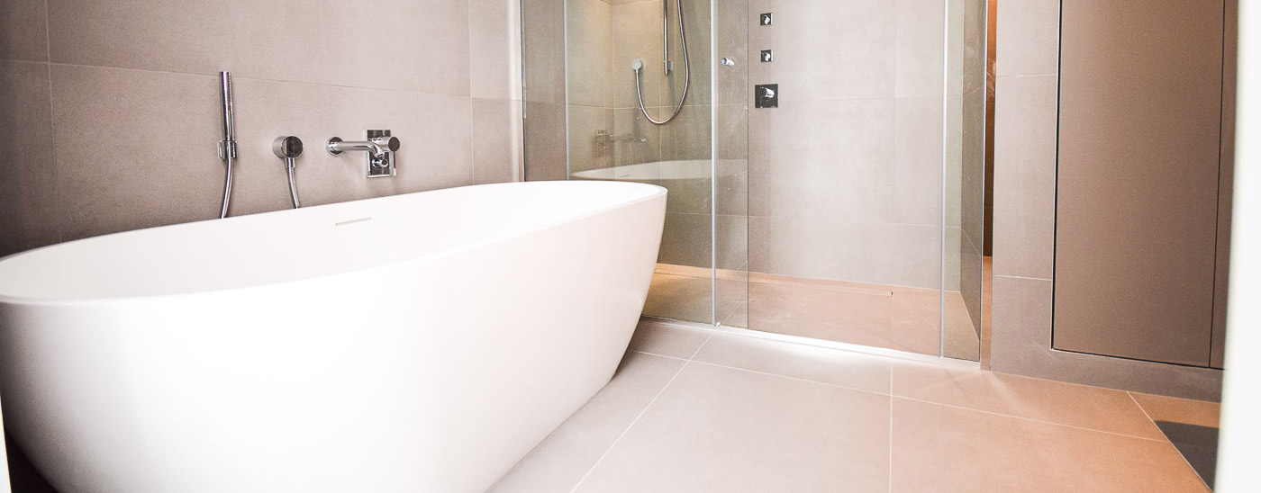 Luxury bathroom renovation with free standing bath and glass partition shower